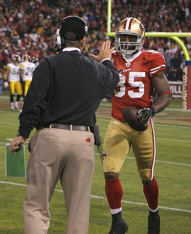 49er head coach Jim Harbaugh congratulates Vernon Davis after his touchdown in the San Francisco 49ers vs. the Pittsburg Steelers at Candlestick Park in San Francisco, Calif., on Monday, December 19, 2011. Photo: John Storey, Special To The Chronicle