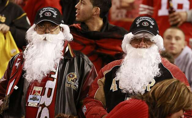 Some fans dressed as Santa at the San Francisco 49ers vs. the Pittsburg Steelers at Candlestick Park in San Francisco, Calif., on Monday, December 19, 2011. Photo: John Storey, Special To The Chronicle