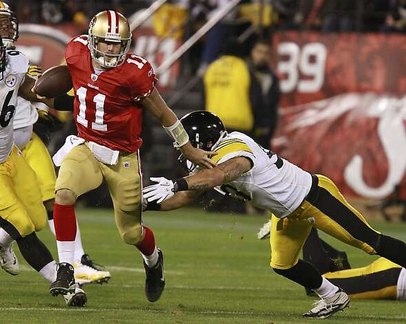 49ers quarterback Alex Smith runs for a 1st down during San Francisco 49ers vs. the Pittsburg Steelers at Candlestick Park in San Francisco, Calif., on Monday, December 19, 2011. Photo: John Storey, Special To The Chronicle