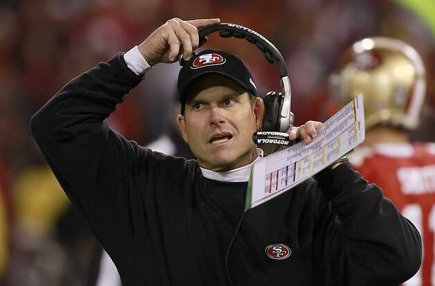 49er head coach Jim Harbaugh puts on his headset during the San Francisco 49ers vs. the Pittsburg Steelers at Candlestick Park in San Francisco, Calif., on Monday, December 19, 2011. Photo: John Storey, Special To The Chronicle