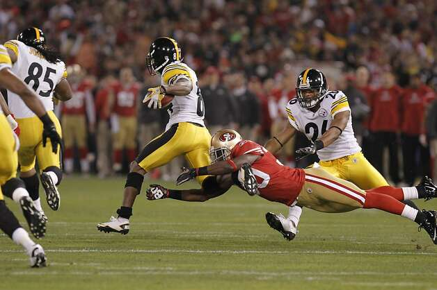 49ers Reggie Smith, (30) dives for a running Steeler Antonio Brown (84) in the first quarter, as the San Francisco 49ers take on the Pittsburgh Steelers, on Monday December 19, 2011, in San Francisco, Ca. Photo: Michael Macor, The Chronicle