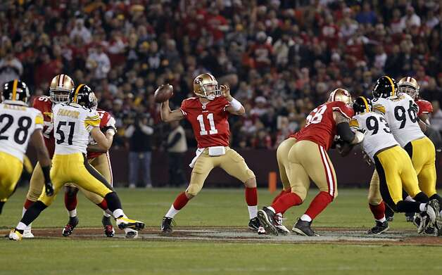 49ers' Alex Smith looks to throw in the first quarter, as the San Francisco 49ers take on the Pittsburgh Steelers, on Monday December 19, 2011, in San Francisco, Ca. Photo: Michael Macor, The Chronicle