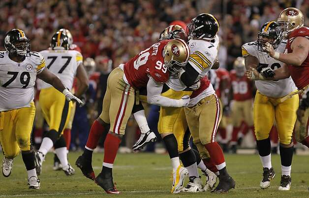 49ers' Aldon Smith, (99), sacks Pittsburgh quarterback Ben Roethlisberger, (7) on a fourth quarter play, as the San Francisco 49ers take on the Pittsburgh Steelers, on Monday December 19, 2011, in San Francisco, Ca. Photo: Michael Macor, The Chronicle