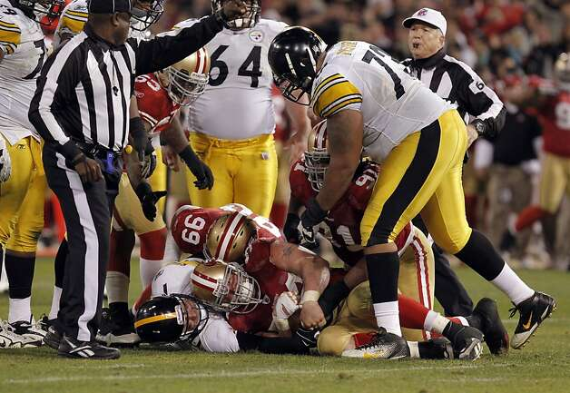 49ers' JUstin Smith, (94) sacks pIttsburgh quarterback Ben Roethlisberger , (7) and recovers a fumble in the fourth quarter, as the San Francisco 49ers take on the Pittsburgh Steelers, on Monday December 19, 2011, in San Francisco, Ca. Photo: Michael Macor, The Chronicle