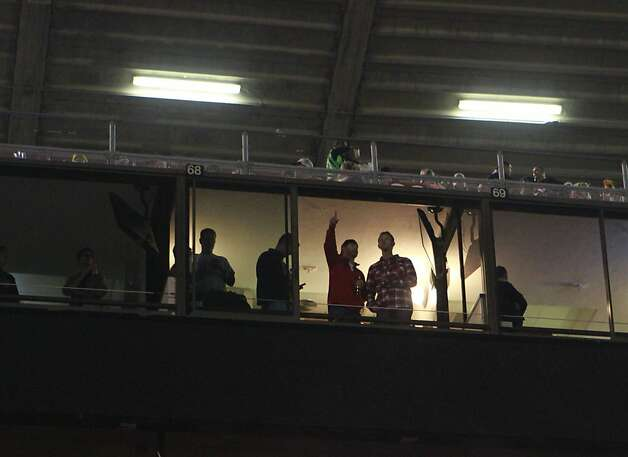 Fans in luxury boxes wait for the lights to come back on during a blackout before the San Francisco 49ers vs. the Pittsburg Steelers at Candlestick Park in San Francisco, Calif., on Monday, December 19, 2011. Photo: John Storey, Special To The Chronicle