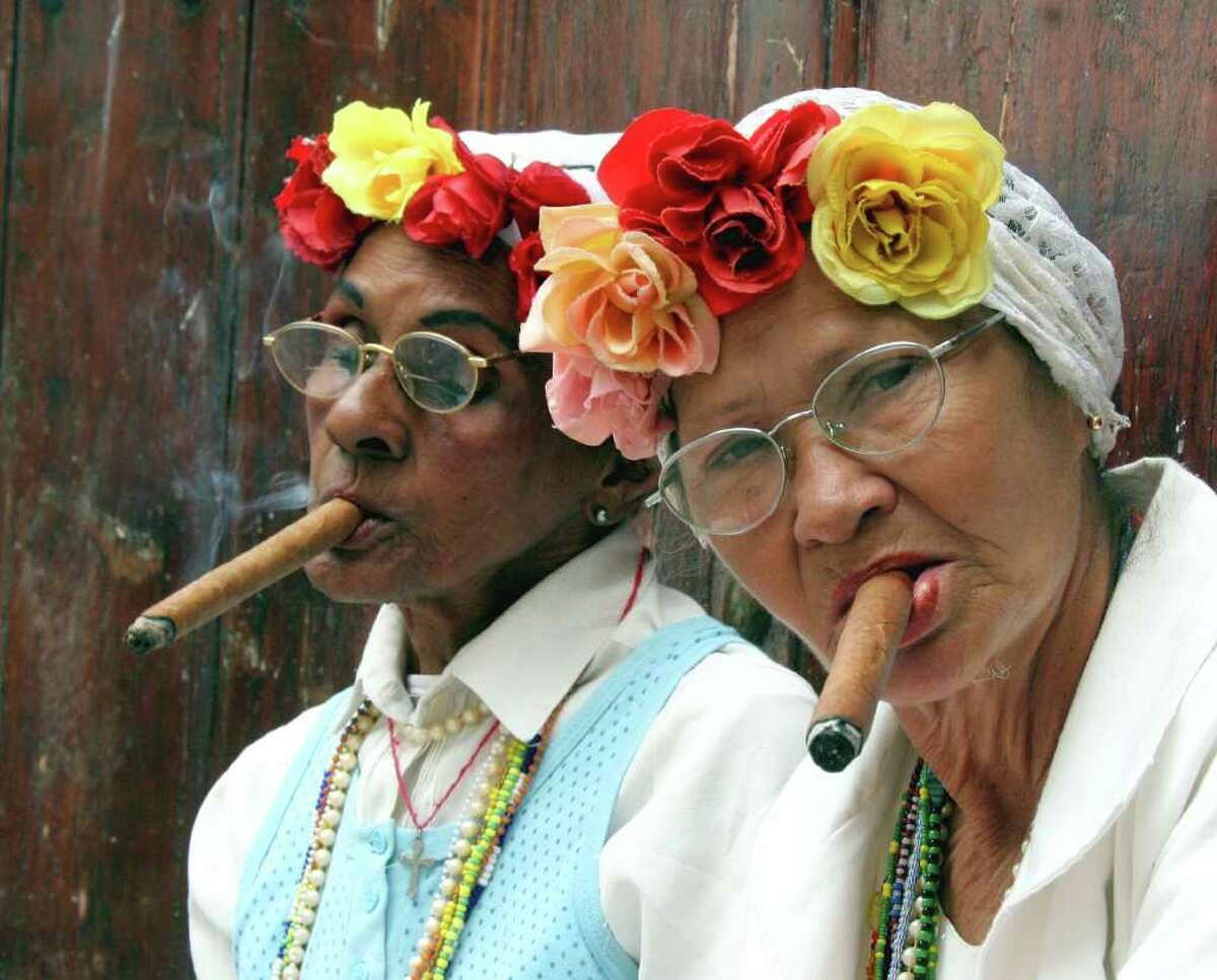 A reader makes a case for a local ban on smoking at parade routes and in backyards, apartments and condominiums. Smoking bans are in vogue, even in cigar-loving Cuba, where these seniors enjoyed a smoke in 2005.