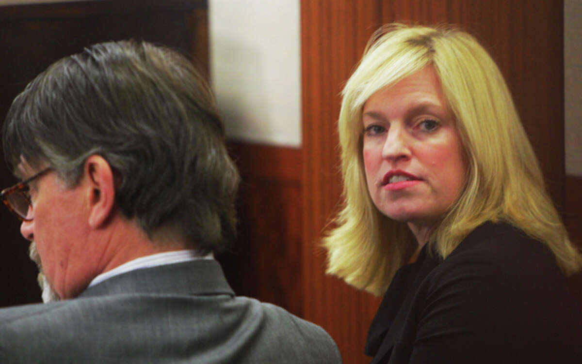 Rachel Palmer sits with one of her attorneys at the hearing to determine whether she will be forced to answer grand jury questions on Dec. 20, 2011.