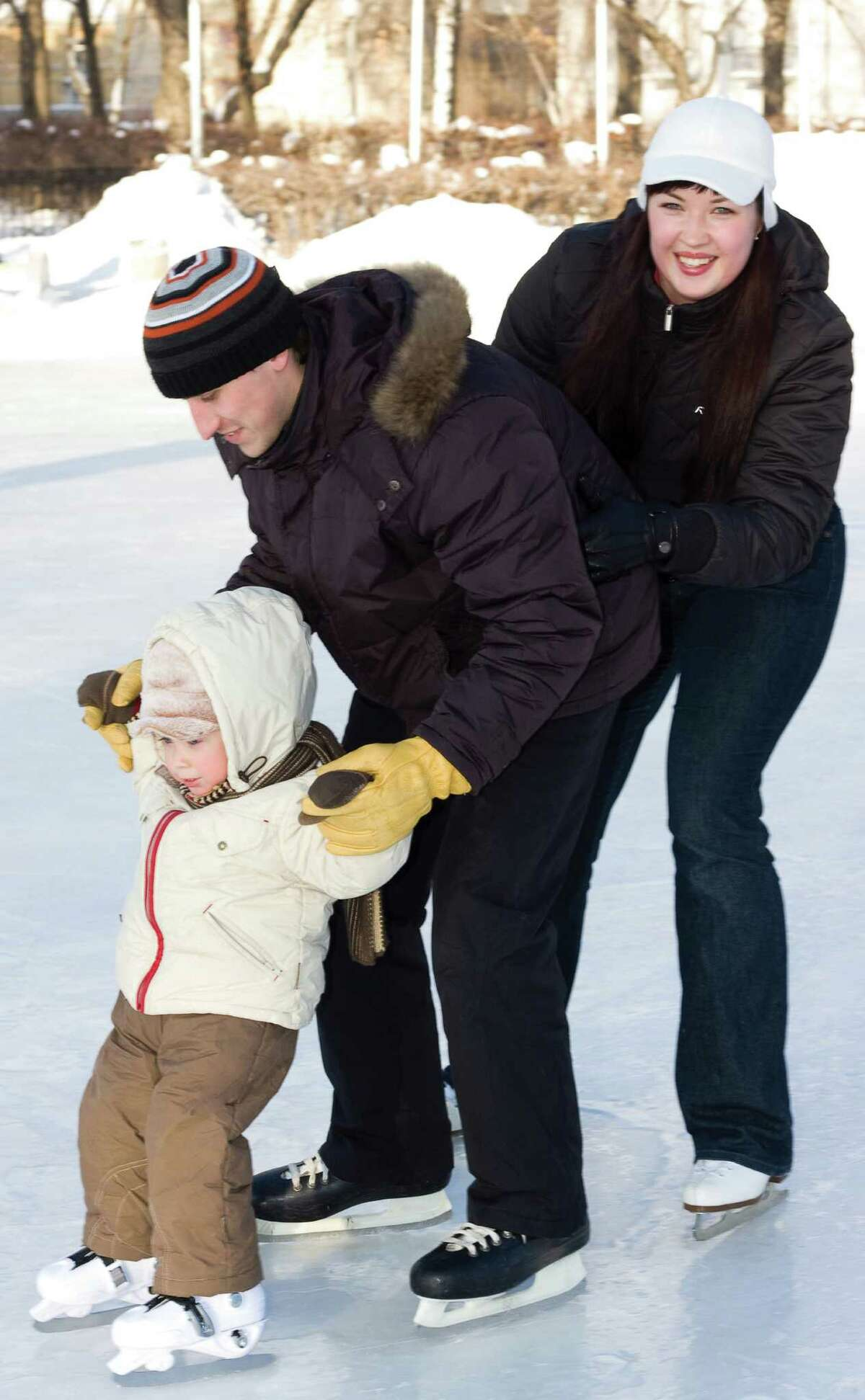 A family at Frostee's Skating Rink at Six Flags Fiesta Texas