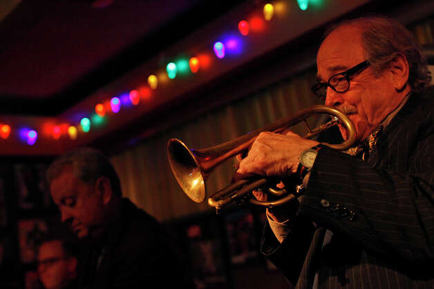 Jim Cullum, of The Jim Cullum Jazz Band, plays at Tucker's Kozy Korner on Tuesday, Nov. 29, 2011.  Photo: LISA KRANTZ, SAN ANTONIO EXPRESS-NEWS / SAN ANTONIO EXPRESS-NEWS