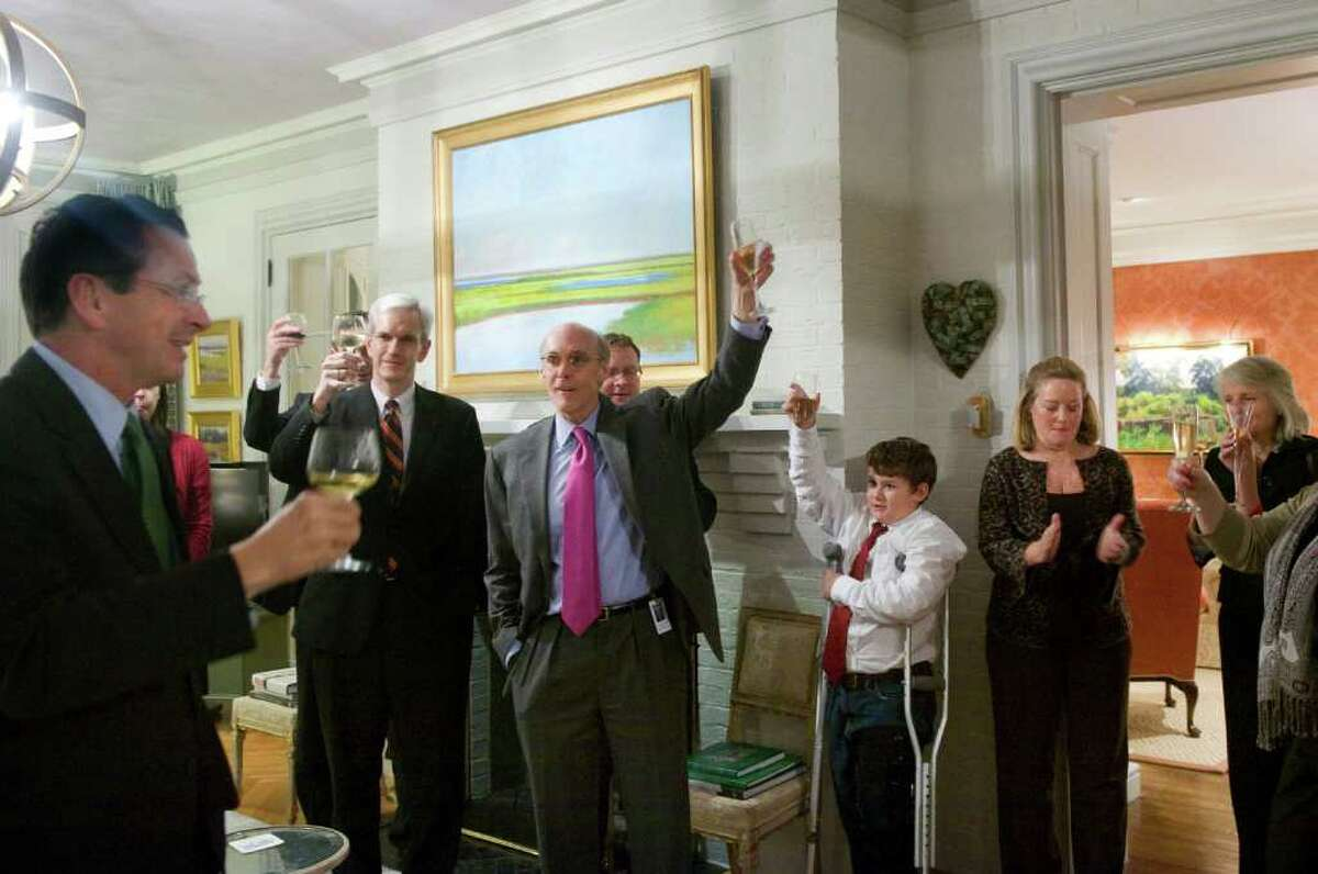 Gov. Dan Malloy leads his staff in a toast after the passage of a bopartisan jobs bill and an incentive package for the Jackson Labratory. The governor and his wife, Cathy, right, hosted a cocktail reception for his staff including Legal Counsel Andrew McDonald, Chief of Staff Tim Bannon, center, and Commissioner of the Connecticut Department of Economic and Community Development Catherine Smith, far right, at the Governor's Mansion in Hartford, Conn., October 27, 2011.