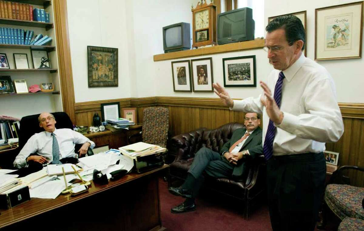 Gov. Dan Malloy meets with Chief of Staff Tim Bannon and Jackson Laboratory's Vice President for Advancement and External Relations Mike Hyde in Bannon's office at the state Capitol in Hartford, Conn., October 26, 2011. Bannon was bullish on the Jackson deal after his wife, Lori Aronson, spotted a newspaper story about their Florida struggles at their house in Bar Harbor, Me.