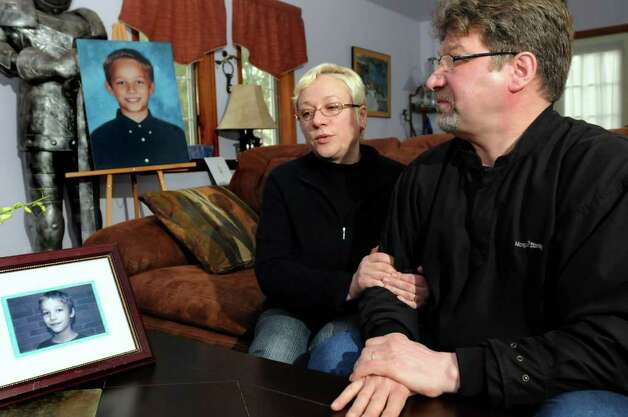 Oxsana and Yuri Naumkin talk about Nicholas, their son who was killed Dec. 22 after a friend shot him accidentally with a handgun, on Saturday, Jan. 1, 2011, at their home in Wilton, N.Y. The Naumkins want changes to the gun permit law so neighbors can find out who has guns in their homes. (Cindy Schultz / Times Union archive) Photo: Cindy Schultz