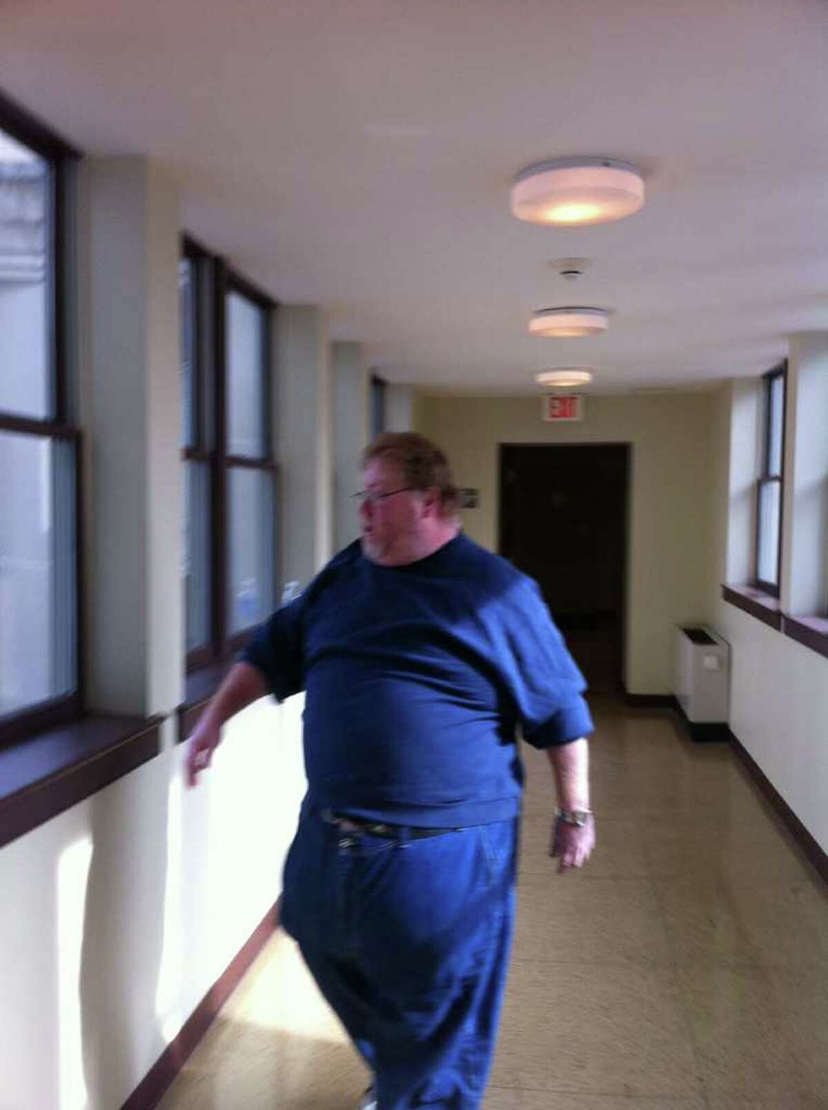 Anthony DeFiglio leaves the grand jury room on Thursday, Nov. 3, 2011, after testifying before the grand jury investigating absentee ballot fraud in Rensselaer County. (Kenneth C. Crowe II / Times Union archive)