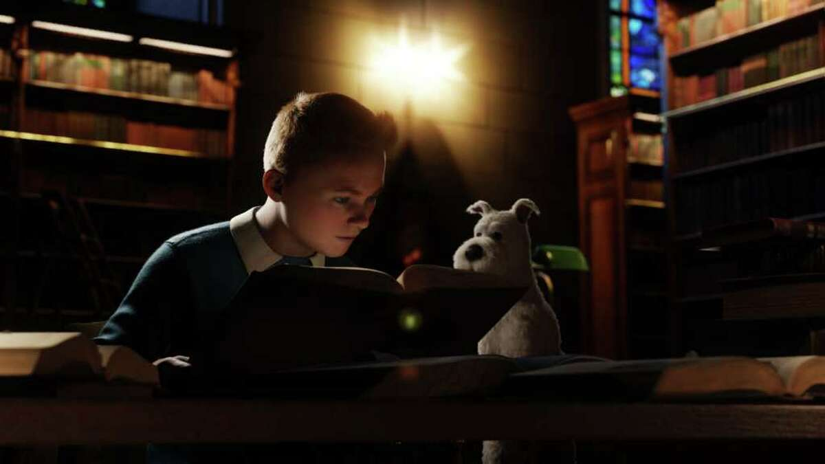 Tintin (Jamie Bell) and Snowy chase down a mystery in