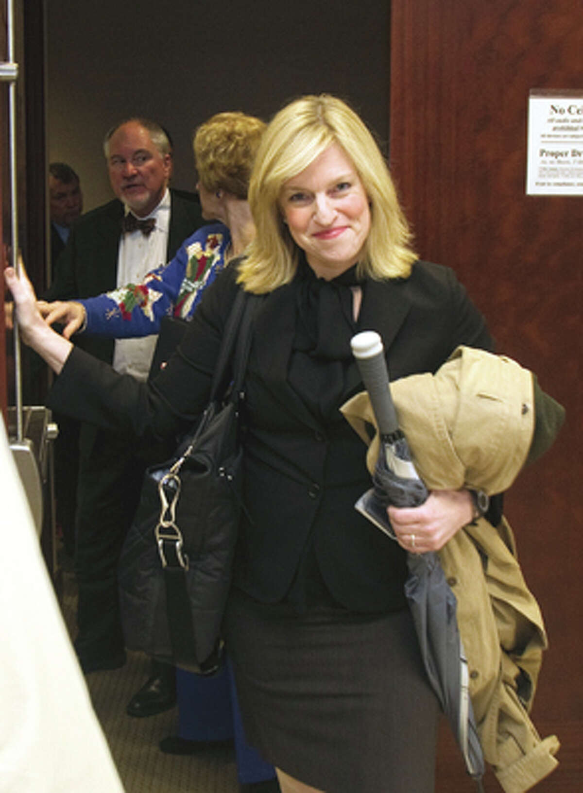 Rachel Palmer leaves the 185th District Court after State District Judge Susan Brown refused to force her to answer grand jury questions Tuesday, Dec. 20, 2011, in Houston. Special prosecutors over a grand jury investigating the district attorney's office will either have to offer Rachel Palmer immunity for her testimony or move on without her. (Cody Duty / Houston Chronicle)