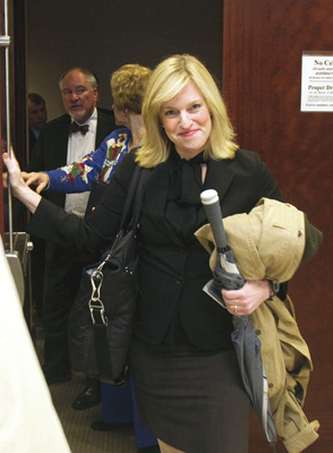 Rachel Palmer leaves the 185th District Court after State District Judge Susan Brown refused to force her to answer grand jury questions Tuesday, Dec. 20, 2011, in Houston. Special prosecutors over a grand jury investigating the district attorney's office will either have to offer Rachel Palmer immunity for her testimony or move on without her. (Cody Duty / Houston Chronicle) Photo: Cody Duty / Chronicle