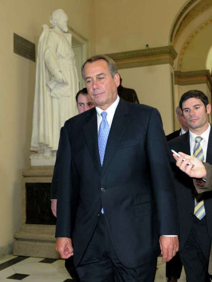 House Speaker John Boehner of Ohio walks to the House floor on Capitol Hill in Washington, Tuesday, Dec. 20, 2011. Republicans in the House of Representatives are set to block a Senate proposal to extend a popular tax cut for working Americans for two months, setting up a showdown between Boehner and his own party in the Senate plus President Obama and the Democrats. (AP Photo/Susan Walsh) Photo: Susan Walsh / AP