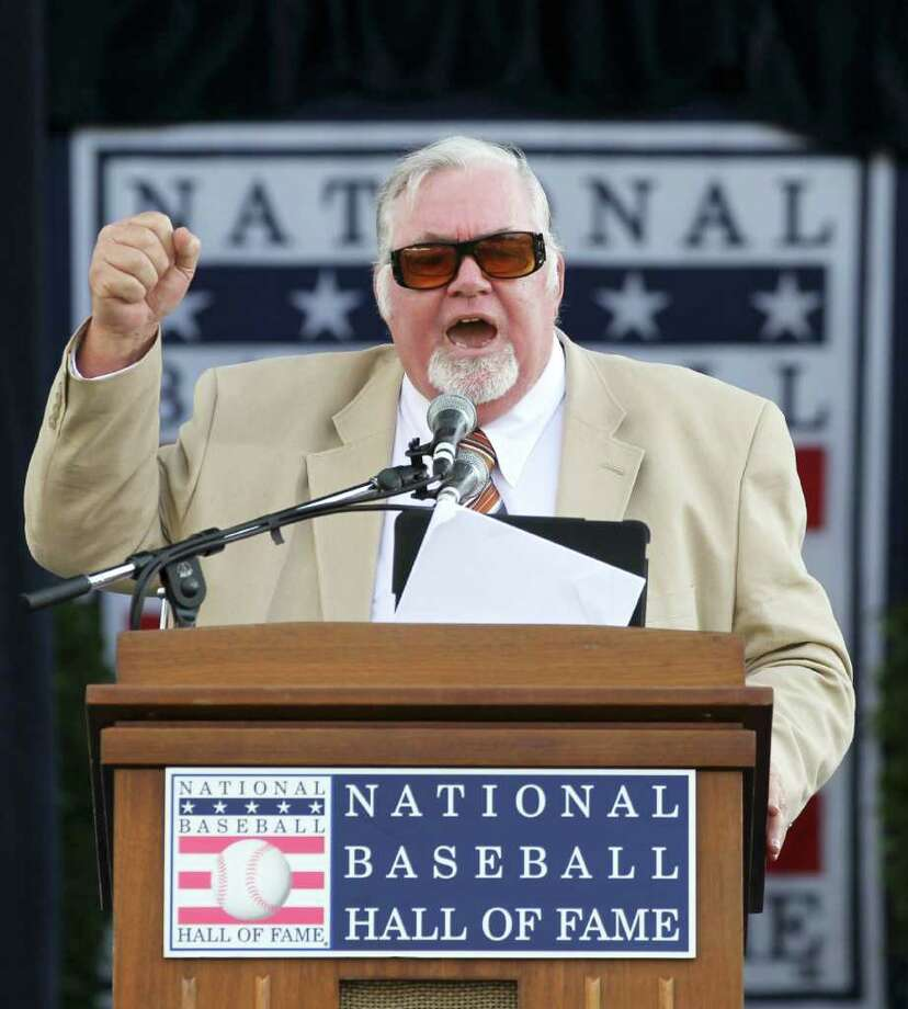 Longtime Philadelphia sports writer Bill Conlin speaks after receiving the J.G. Taylor Spink Award during a ceremony at Doubleday Field in Cooperstown, N.Y., on Saturday, July 23, 2011.  (AP Photo/Mike Groll) Photo: Mike Groll / AP