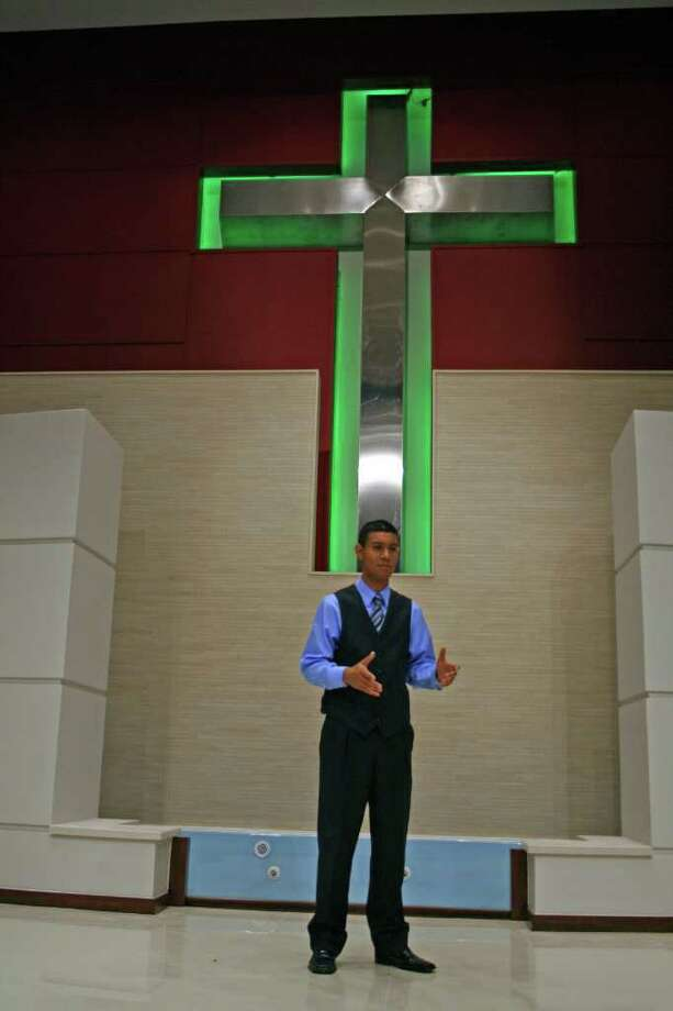 TOM BEHRENS PHOTO PASTOR: Santiago Pacheco leads Succeed in Life Center at 6115 Southwest Freeway. Photo: Tom Behrens