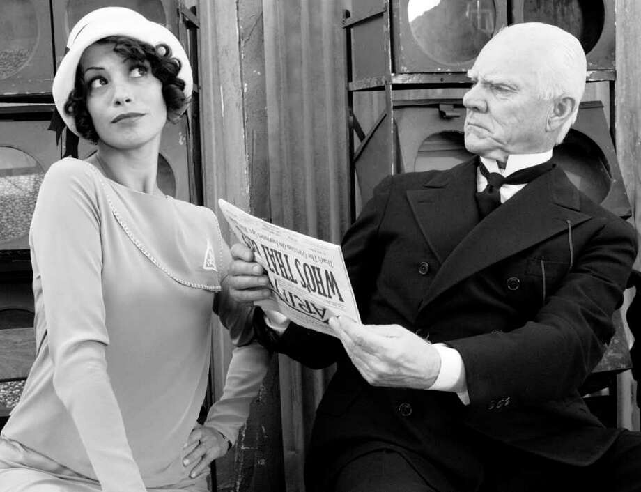 Berenice Bejo as Peppy Miller and Malcolm McDowell as The Butler in Michel Hazanavicius's film THE ARTIST Photo: Peter Iovino, The Weinstein Co.