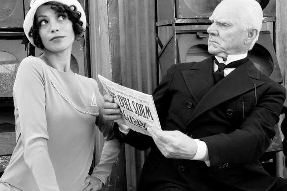 Berenice Bejo as Peppy Miller and Malcolm McDowell as The Butler in Michel Hazanavicius's film THE ARTIST
