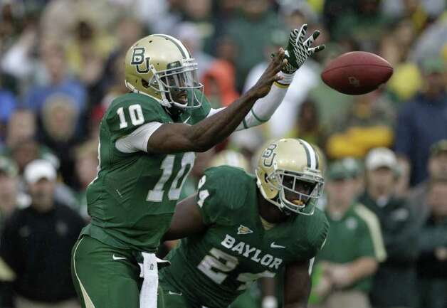 Baylor quarterback Robert Griffin III (10) and running back Terrance Ganaway (24) during an NCAA college football game against Texas Saturday, Dec. 3, 2011, in Waco, Texas. Baylor won 48-24. Photo: AP