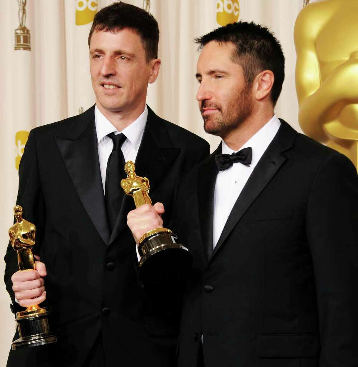 Atticus Ross (left) and Trent Reznor, winners of the award for Best Original Score for 'The Social Network', pose in the press room during the 83rd Annual Academy Awards held at the Kodak Theatre on February 27, 2011 in Hollywood, California.
