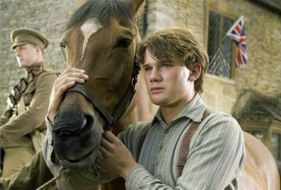 """In this film image released by Disney, Jeremy Irvine is shown in a scene from """"War Horse."""" The film was nominated Thursday, Dec. 15, 2011 for a Golden Globe award for best motion picture drama. The Golden Globes will be presented Jan. 15 at the Beverly Hilton Hotel, televised live by NBC and hosted by Ricky Gervais. Photo: AP"""