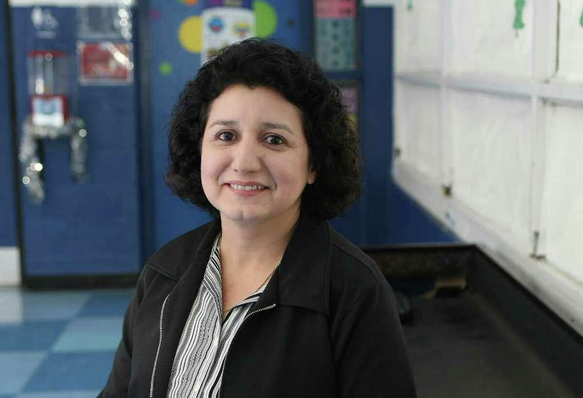 CONEXION: Doris Guajardo, a recent OLLU grad who went back to school after losing her job in her mid-40s, is one of this year's Stories of Hope. Doris just started an accounting job at the Boys and Girls Club. HELEN L. MONTOYA/hmontoya@express-news.net