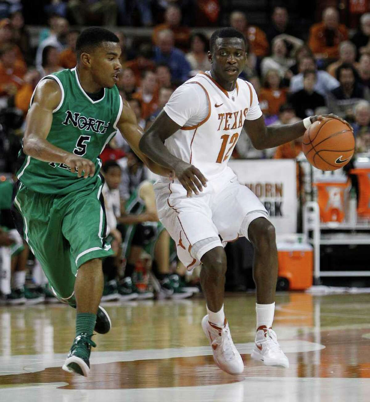 UT freshman Myck Kabongo (right), being guarded by North Texas' Chris Jones earlier this season, has impressed his teammates with his speed going up the court. He is averaging 10.8 points and 6.0 assists per game.