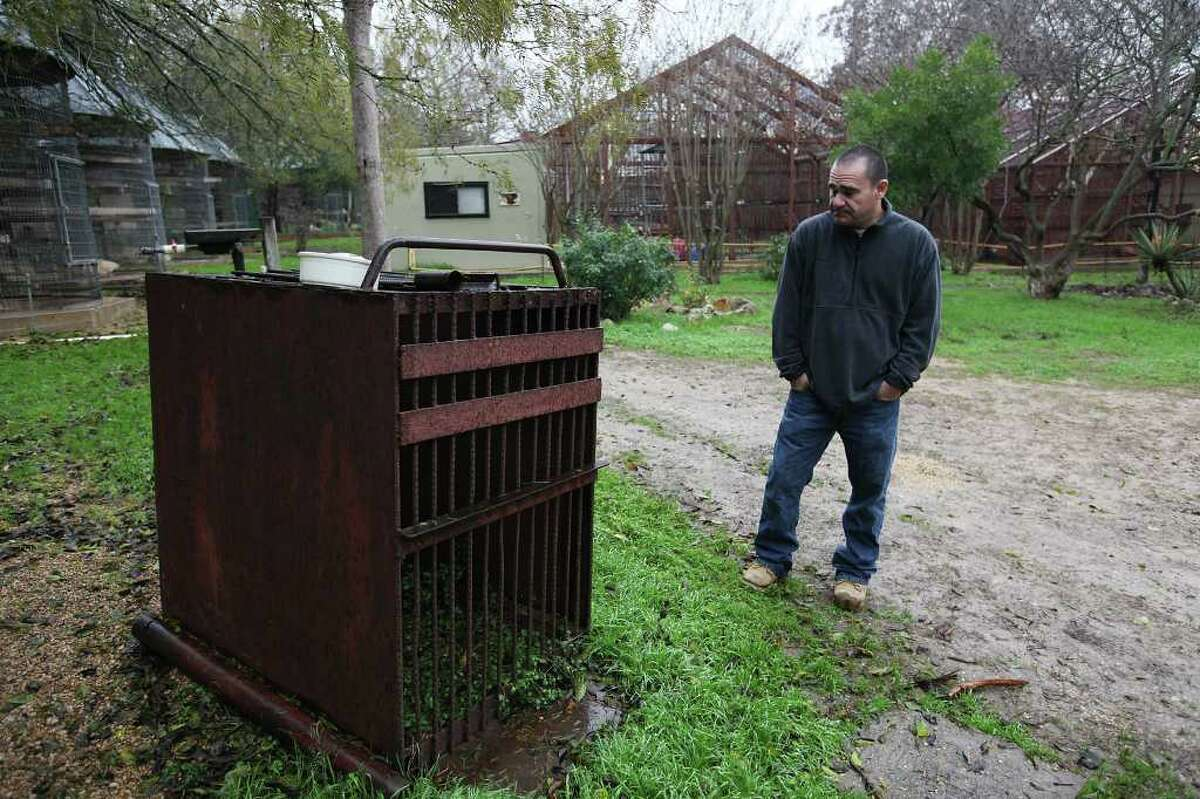 Primarily Primates executive director Stephen Rene Tello stands by the cage that chimpanzee