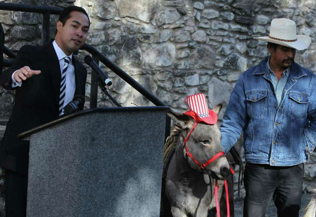 Mayor Julian Castro announces Tuesday that the building behind him at Brackenridge Park and a 2.6 acre area around it, once known as the donkey barn, will be redeveloped into an eduation center with plant and animal exhibits. The project requires approval from city council and will cost about $500,000. On the right holding the donkey is Rusty Tinajero. (Tuesday December 20, 2011) JOHN DAVENPORT/jdavenport@express-news.net