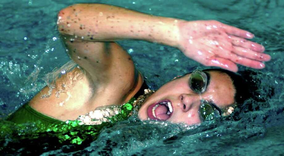 SPECTRUM/Candice Weiss of New Milford High School swimming. December 2011 Photo: Norm Cummings