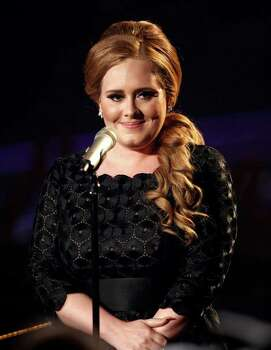 FILE - In this Aug. 28, 2011 file photo, singer Adele appears at the MTV Video Music Awards in Los Angeles. Adele is the leading nominee at the American Music Awards, but the British singer won?t be at the ceremony Sunday, Nov. 20, 2011, in Los Angeles because she is recovering from recent throat surgery. (AP Photo/Matt Sayles, File) Photo: Matt Sayles / AP2011