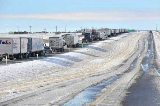 Westbound traffic is backed-up for miles on Interstate 40 west of Bushland, Texas while emergency crews remove vehicles involved in an accident that closed several lanes Tuesday, Dec. 20, 2011. Travelers in the Texas Panhandle were urged to stay off ice-packed roads Tuesday after up to 10 inches of snow covered parts of the region. Photo: AP