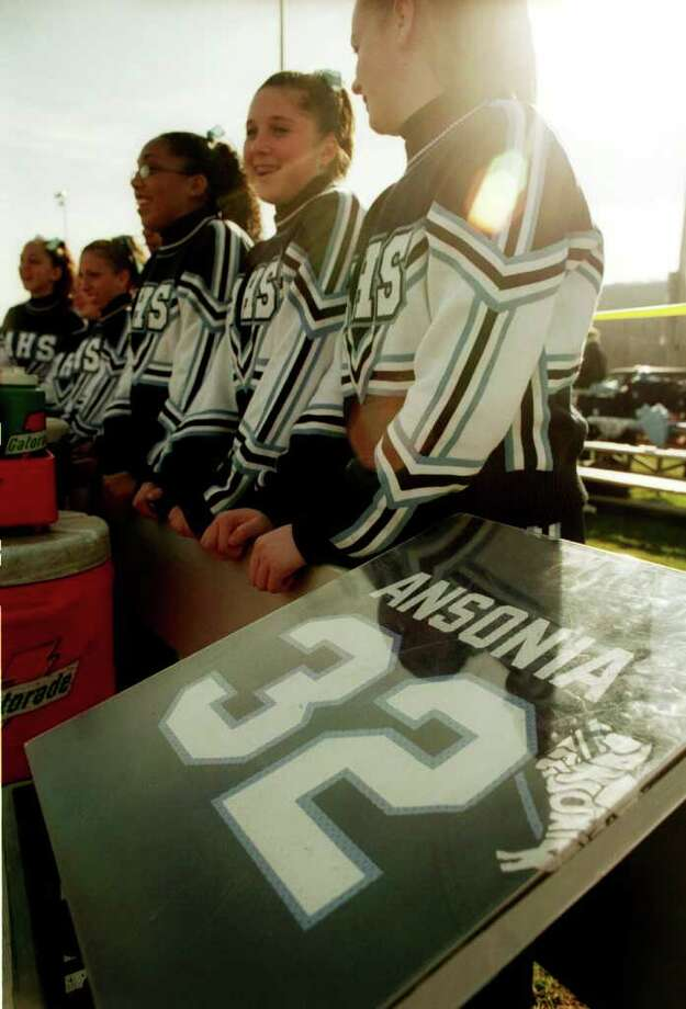 The jersey of slain Ansonia football player Damontis Johnson has a special place on the bench during the Chargers' Thanksgiving Day game versus Naugatuck, Nov. 27th, 2003. Johnson was shot and killed a year before, Nov. 27th, 2002. Photo: Brian A. Pounds / Connecticut Post