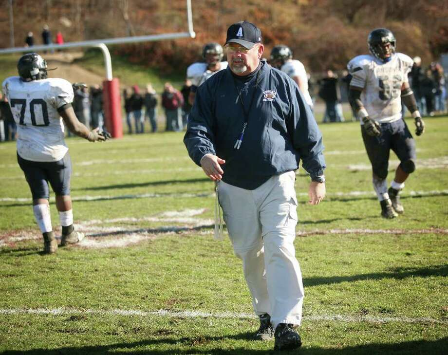 Ansonia assistant football coach Kevin Rowley comes off the field during the 2011 Thanksgiving Day football game at Naugatuck High School. Rowley was the youth football coach of Nigel Ingram and his former teammates. Photo: Brian A. Pounds