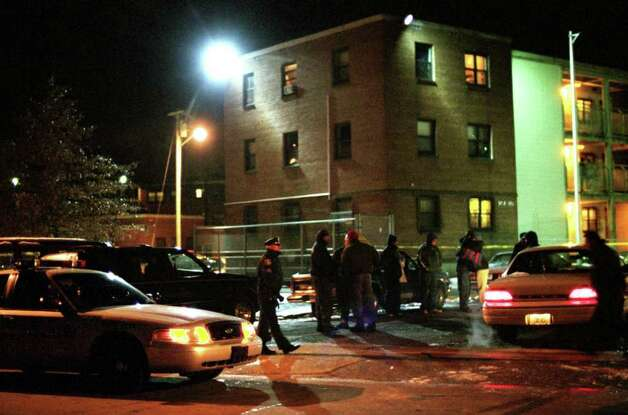 The scene outside Riverside Apartments in Ansonia, Conn. Nov. 27th, 2002 following the shooting death of Ansonia High School football player Damontis Johnson on the eve of the annual Thanksgiving Day game against Naugatuck. Photo: File Photo / Connecticut Post File Photo