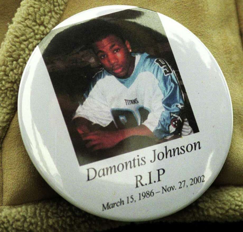 A button worn at the funeral for Damontis Johnson, in Ansonia, Conn. Dec. 2nd, 2002. Johnson, an Ansonia High School football player, was shot and killed Nov. 27th, 2002. Photo: Ned Gerard
