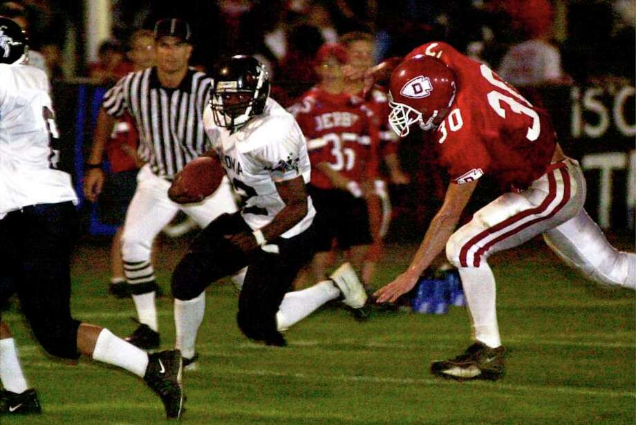Ansonia's Damontis Johnson runs the ball in a game against Derby during the 2002 season. Johnson was shot a killed in Ansonia on Nov. 27th, 2002, the day before Thanksgiving. Photo: Christian Abraham / Connecticut Post