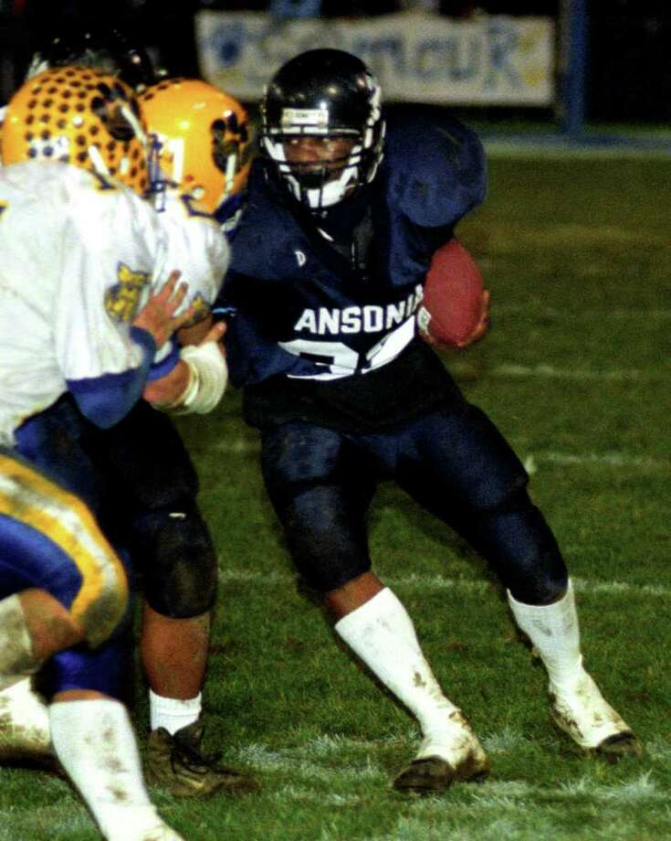 Ansonia's Damontis Johnson runs the ball November 21, 2002, in a game against Seymour. The following week, on the evening before Thanksgiving, Damontis was shot and killed in Ansonia. Photo: Christian Abraham / Connecticut Post