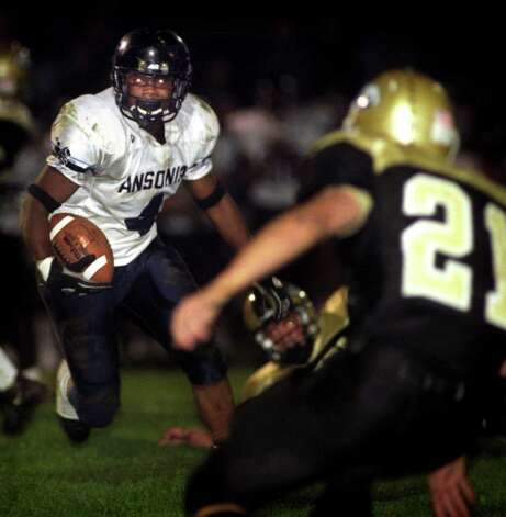 Ansonia's Darnell Cooks returns an interception early in the third quarter of a game against Woodland High School, in Beacon Falls, Conn. Sept. 26th, 2003. Photo: File Photo / Connecticut Post/Jeff Bustraan