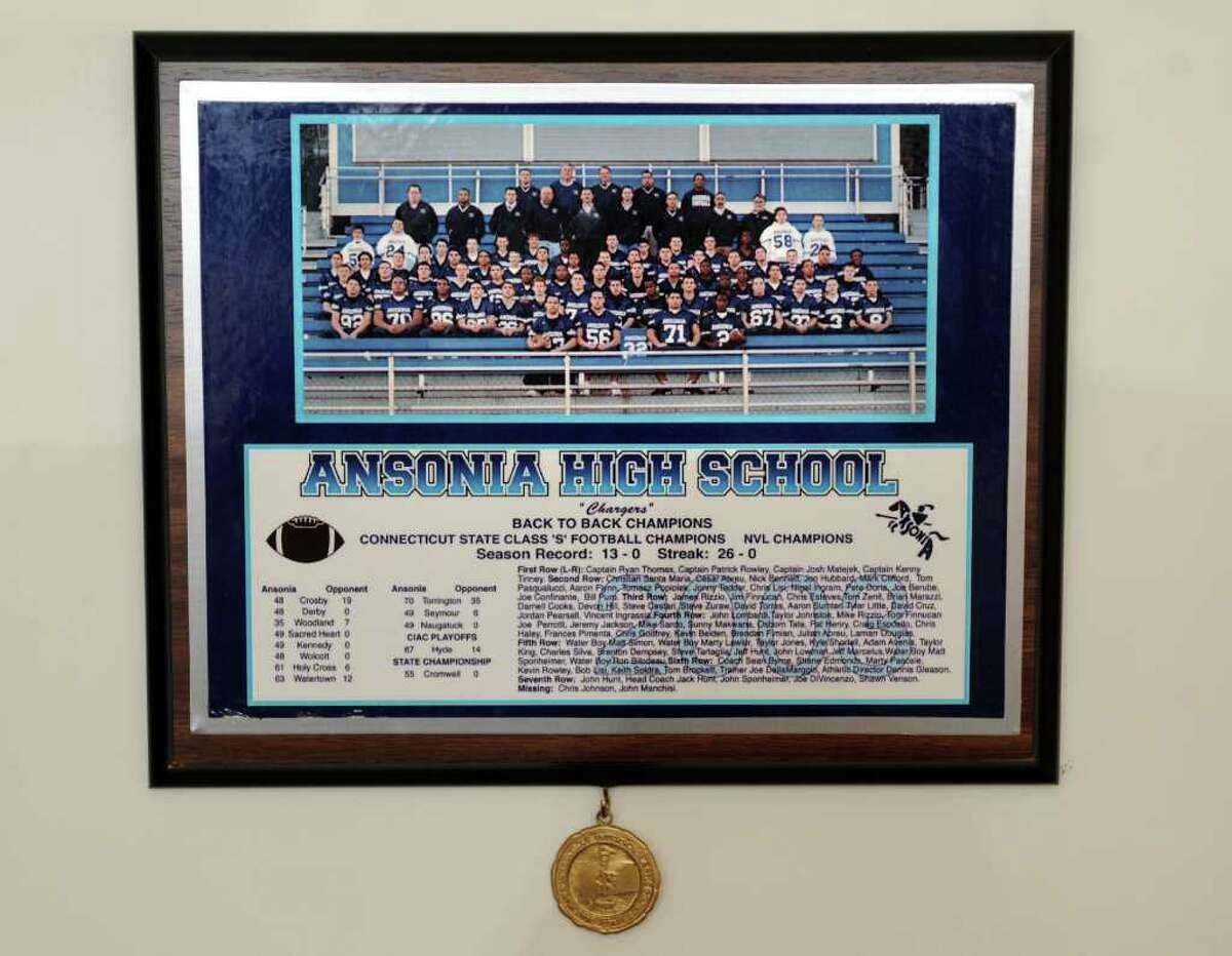 A photo of the 2002/2003 Ansonia High School back-to-back state championship winning football team.