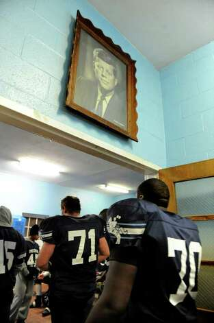 A look at the Ansonia football program and the multi-generational reach it has, during a recent game against Wilby in Ansonia, Conn. on Friday November 11, 2011. A portrait of John F. Kennedy hands on the wall as the team enters the locker room at halftime. Photo: Christian Abraham / Connecticut Post