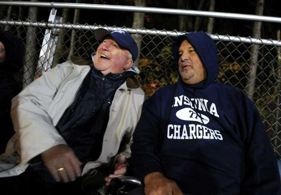 A look at the Ansonia football program and the multi-generational reach it has, during a recent game against Wilby in Ansonia, Conn. on Friday November 11, 2011. Ed Morse, left, and , Carl Dzienkiewicz, who both played for Ansonia High on the football team, watch a recent Friday night game. Photo: Christian Abraham / Connecticut Post