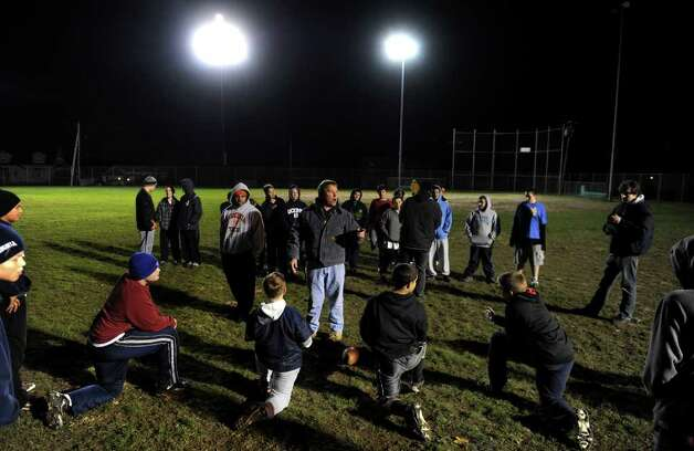 A look at the Ansonia football program and the multi-generational reach it has, during a recent game against Wilby in Ansonia, Conn. on Friday November 11, 2011. Coach Bob Jones works with youngsters in the Ansonia Youth Football as they practice nearby during game night and prepare for an upcoming game. Photo: Christian Abraham / Connecticut Post