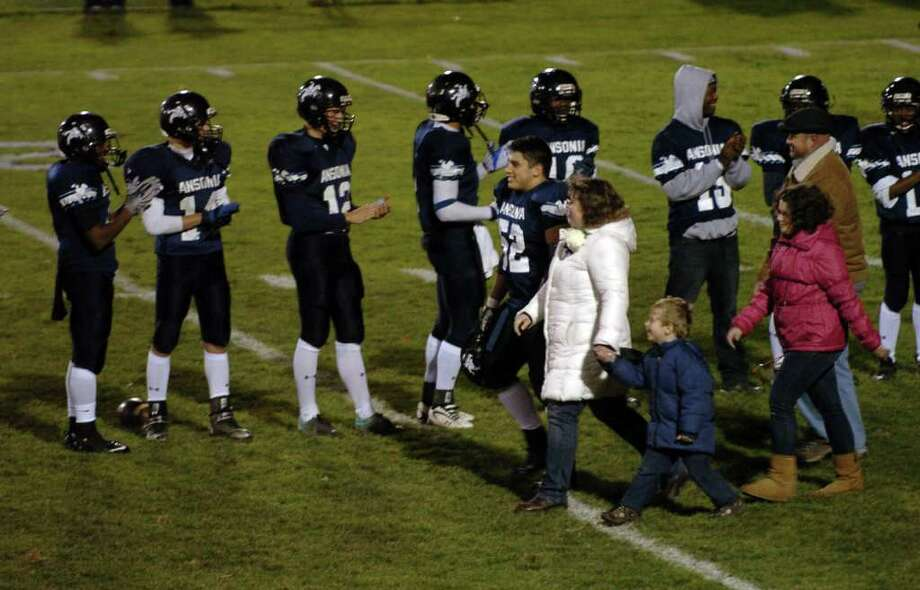 A look at the Ansonia football program and the multi-generational reach it has, during a recent game against Wilby in Ansonia, Conn. on Friday November 11, 2011. Ansonia team members take part in senior night with their families. Photo: Christian Abraham / Connecticut Post