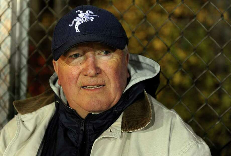 A look at the Ansonia football program and the multi-generational reach it has, during a recent game against Wilby in Ansonia, Conn. on Friday November 11, 2011. Ed Morse, who played for Ansonia High on the football team in the 1950's, watches a recent Friday night game. Photo: Christian Abraham / Connecticut Post