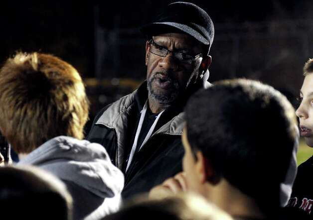 A look at the Ansonia football program and the multi-generational reach it has, during a recent game against Wilby in Ansonia, Conn. on Friday November 11, 2011. Coach Chuck Albea talks with youngsters in the Ansonia Youth Football as they practice nearby during game night and prepare for an upcoming game. Photo: Christian Abraham / Connecticut Post