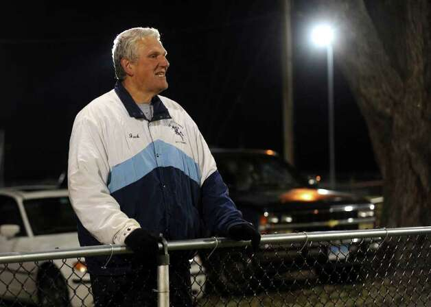 A look at the Ansonia football program and the multi-generational reach it has, during a game against Wilby in Ansonia, Conn. on Friday November 11, 2011. Retired Head Coach Jack hunt watches the action. Photo: Christian Abraham / Connecticut Post